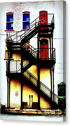 Red Doors On Black Fire Escape Canvas Print by Janine Riley