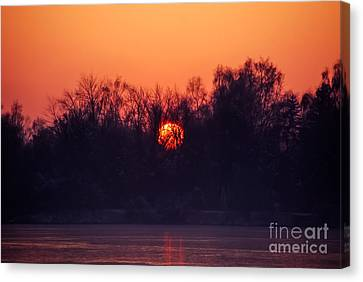 Red Fire Ball Canvas Print by Hannes Cmarits
