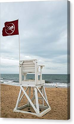 Red Flag At A Beach Canvas Print