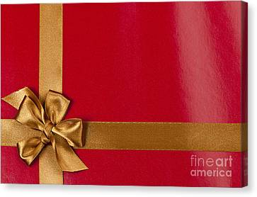 Red Gift Background With Gold Ribbon Canvas Print