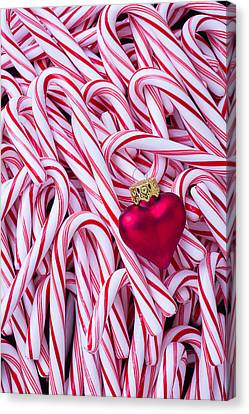 Red Heart Ornament On Candy Canes Canvas Print