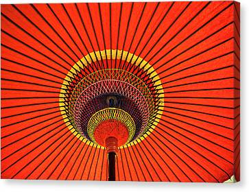 Red Japanese Paper Umbrella Opened Canvas Print by Sheila Haddad