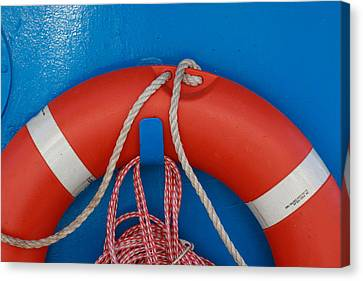 Red Life Belt On Blue Wall Canvas Print by Ulrich Kunst And Bettina Scheidulin