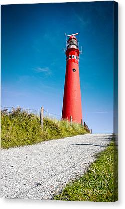 Red Lighthouse And Deep Blue Sky. Canvas Print by Jan Brons