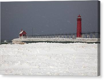 Red Lighthouses - Winter - Stormy Weather Canvas Print by John Stephens