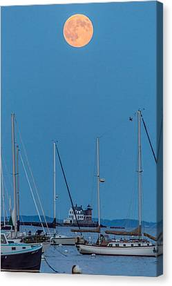 Red Moon Over Breakwater Canvas Print