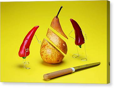 Red Peppers Sliced A Pear Canvas Print by Paul Ge