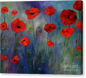 Red Poppies Blue Fog Canvas Print by Claire Bull