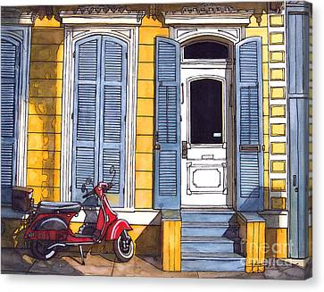 Red Scooter With Yellow House And Blue Shutters Canvas Print by John Boles