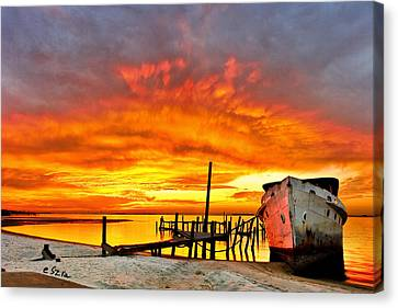 Red Sunset - Beached Ship At Sunset Canvas Print by Eszra Tanner