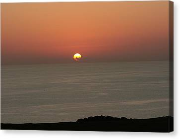 Red Sunset Over Sea Canvas Print by Gordon Auld
