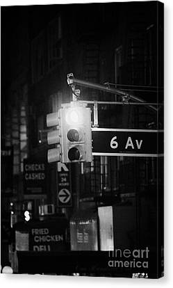Manhaten Canvas Print - red traffic stop sign on 6th Avenue at night new york city by Joe Fox