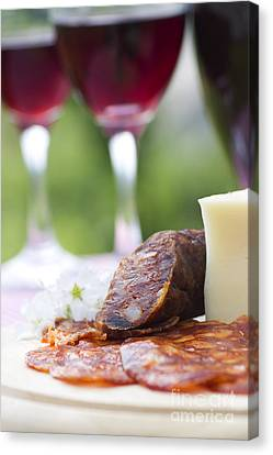 Red Wine And Sausage With Cheese Canvas Print by Mythja  Photography