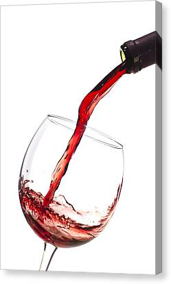 Red Wine Pouring Into Wineglass Splash Canvas Print