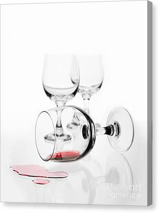 Overturned Wine Glass With Red Wine Splashed Out  Canvas Print by Arletta Cwalina