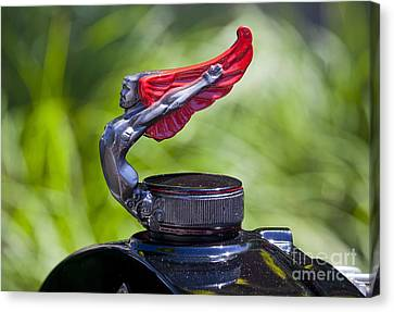Red Wings Hood Ornament Canvas Print by Chris Dutton