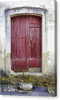 Red Wood Door Of The Medieval Village Of Pombal Canvas Print by David Letts