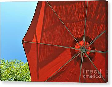 Reddish Umbrella Against Blue Sky Canvas Print by Sami Sarkis