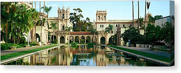Reflecting Pool In Front Of A Building Canvas Print by Panoramic Images