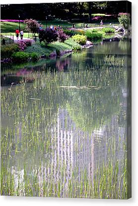 Reflection And Movement Canvas Print by Menachem Ganon