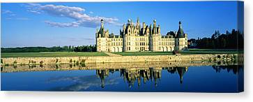 Reflection Of A Castle On Water Canvas Print