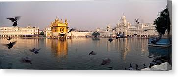 Punjab Canvas Print - Reflection Of A Temple In A Lake by Panoramic Images