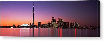 Reflection Of Buildings In Water, Cn Canvas Print by Panoramic Images