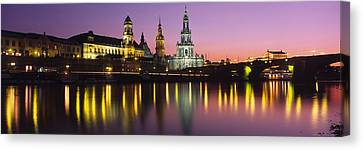 Reflection Of Buildings On Water At Canvas Print by Panoramic Images