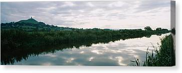Reflection Of Clouds In The River Canvas Print by Panoramic Images