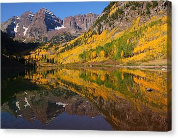 Reflection Of Maroon Bells During Autumn Canvas Print by Jetson Nguyen