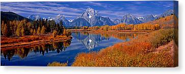 Reflection Of Mountains In The River Canvas Print by Panoramic Images