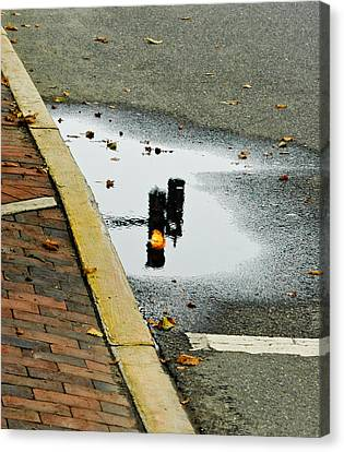 Canvas Print featuring the photograph Reflection Of Traffic Light In Street Puddle by Gary Slawsky