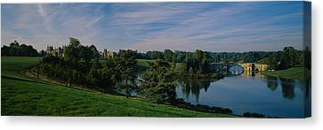 Reflection Of Trees And A Bridge Canvas Print by Panoramic Images