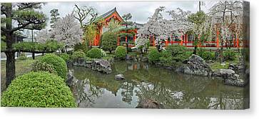 Reflection Of Trees In Pond Canvas Print by Panoramic Images