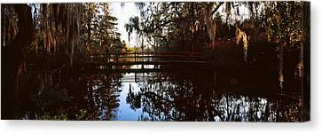 Reflection Of Trees In Water, Magnolia Canvas Print by Panoramic Images
