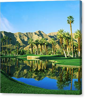 Reflection Of Trees On Water In A Golf Canvas Print