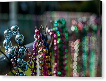 Reflections In Mardi Gras Beads Canvas Print by Andy Crawford