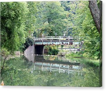Reflections Of A Bridge Canvas Print by Adam L