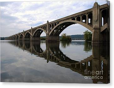 Reflections Of A Bridge Canvas Print by Scott D Welch