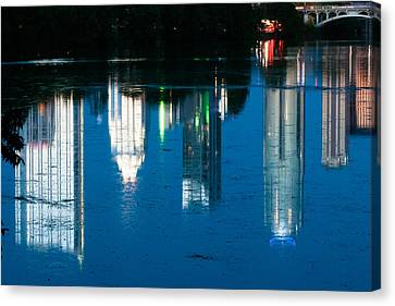 Reflections Of Austin Skyline In Lady Bird Lake At Night Canvas Print by Jeff Kauffman