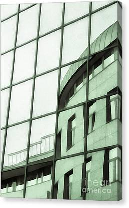Reflections On The Building Canvas Print by Odon Czintos