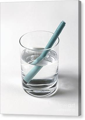 Refraction Pen In Glass Of Water Canvas Print by Stephen Oliver / Dorling Kindersley