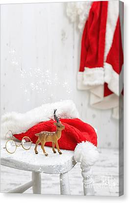Reindeer With Santa Hat Canvas Print by Amanda Elwell