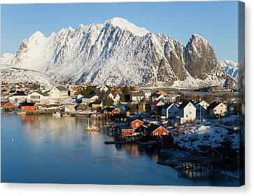 Reine Village In Winter, Lofoten Canvas Print by Peter Adams