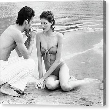 Rene Russo With A Man On A Beach Canvas Print by Francesco Scavullo