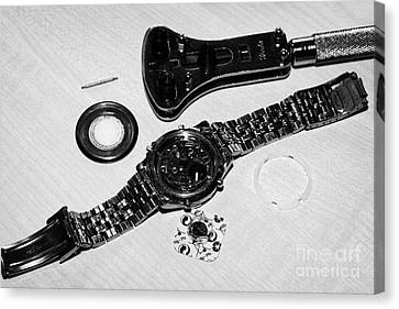 Replacing The Battery In A Metal Band Wristwatch Canvas Print by Joe Fox