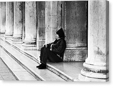 Resting At St. Mark's Square Canvas Print by John Rizzuto