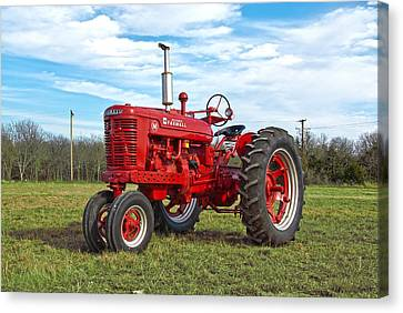 Restored Farmall Tractor Canvas Print by Charles Beeler