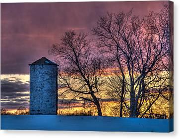 Retired Silo Watching Sunset Canvas Print by Paul Freidlund
