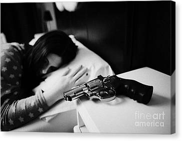 Revolver Handgun On Bedside Table Of Early Twenties Woman In Bed In A Bedroom Canvas Print by Joe Fox